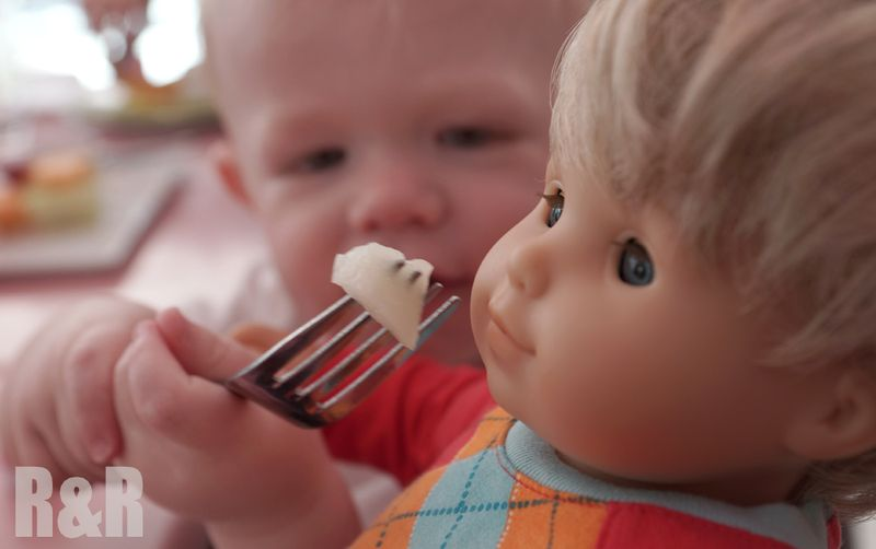 Feeding AG doll