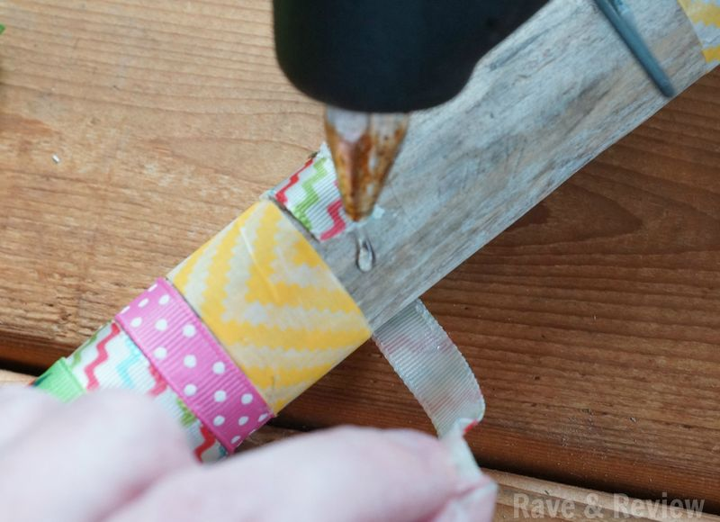 Gluing ribbon on walking stick