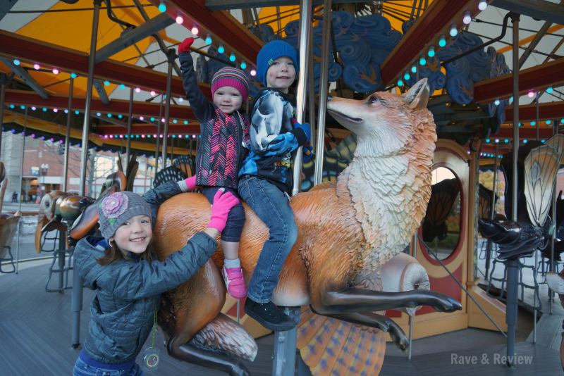 Three kids on carousel
